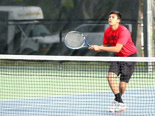 Garden City's Rodrigo Andrade watches after he returned a shot against Sanderson during boys doubles action at the Region II-1A Tennis Tournament Thursday at Bentwood Country Club.