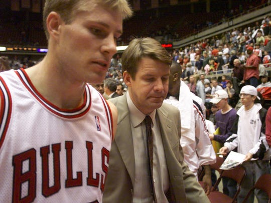 Fred Hoiberg, left, walks off the court with his former coach, Tim Floyd. The build-up to Floyd becoming the Bulls coach in 1998 sounds awfully similar to the one involving his former player Hoiberg.