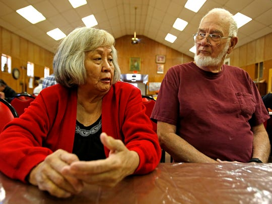 Rosemarie Collyer, left, of Fruitland, talks with Ronald
