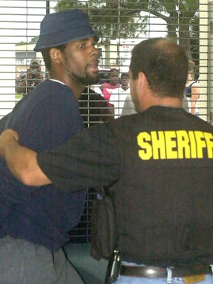 R. Kelly has yet to face consequences after accusers went public with accusations of underage sex and abusive treatment in interviews with BuzzFeed and Rolling Stone. Kelly, who denied the allegations through his attorney, canceled a few dates on his concert tour. In this photo a Polk County Sheriff deputy escorts Kelly into the East Central Comand Center Winter Haven, Fla., June 5, 2002. R. Kelly was indicted earlier on  21 counts of child pornography.