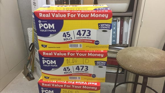 Boxes of Pom toilet paper ordered by Barbara Carroll in Atlanta for the office building she manages.