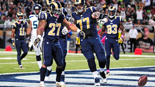 St. Louis Rams running back Tre Mason celebrates his first NFL touchdown.