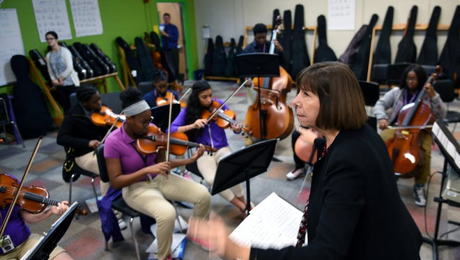 "Isaiah T. Creswell Middle Arts Magnet music teacher Beth Voltz directs students while playing the song ""Thriller"" during strings class on Nov. 5, 2015."