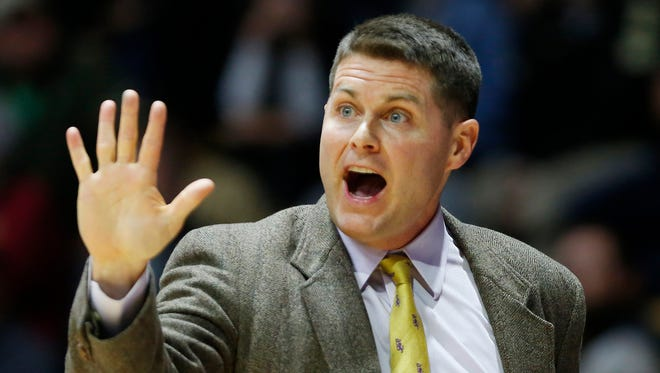 Carroll College head coach Carson Cunningham shouts directions to his players as they battle Purdue Wednesday, November 1, 2017, at Mackey Arena. Purdue defeated Carroll College 98-71.