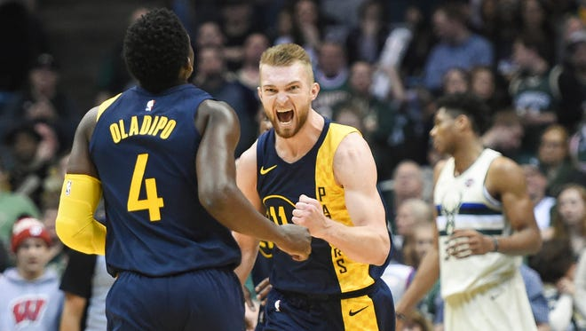 Indiana Pacers center Domantas Sabonis (11) reacts after guard Victor Oladipo (4) scored a basket late in the fourth quarter during the game against the Milwaukee Bucks at the BMO Harris Bradley Center.