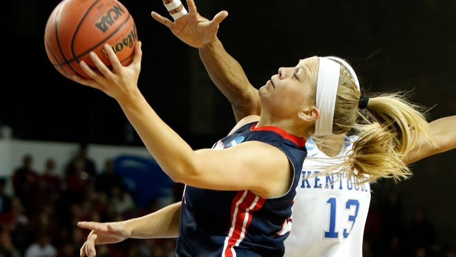 Belmont's Kylee Smith, left, shoots while defended by Kentucky's Evelyn Akhator, right, during a first-round game in the women's NCAA tournament in Lexington, Ky., Friday, March 17, 2017.