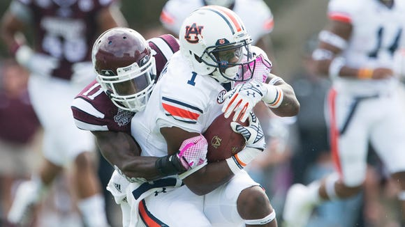 Auburn wide receiver D'haquille Williams (1) is tackled by Mississippi State Kivon Coman (11) during the NCAA football game on Saturday, Oct. 11, 2014, between Auburn and Mississippi State at Davis Wade Stadium in Starkville, Miss.