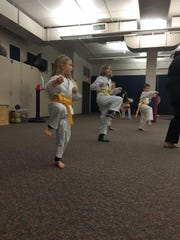 The students at St. Mary Elementary School have the opportunity to participate in enrichment classes. These students participate in karate on Saturdays. They study the art of Okinawan Shorei Kempo and have opportunities to progress toward a black belt. Pictured are (left) Adel Schneider and her sister, Eva Schneider.