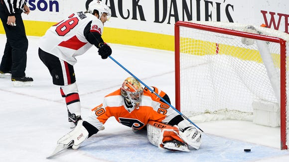 Feb 3, 2018; Philadelphia, PA, USA; Ottawa Senators left wing Mike Hoffman (68) scores the game winning goal past Philadelphia Flyers goalie Michal Neuvirth (30) during a shootout at Wells Fargo Center. Mandatory Credit: Derik Hamilton-USA TODAY Sports