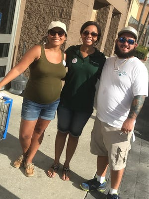 Helping with Tools for Schools are, from left, Melanie Baculima, Cherelle Mansfield and Chris Kranker.