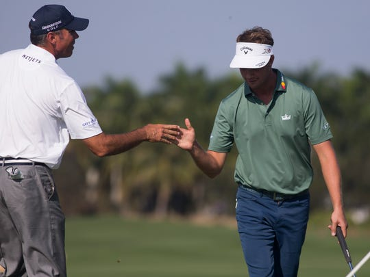 Matt Kuchar, left, and teammate Harris English congratulate each other during the first round of the Franklin Templeton Shootout at Tibur—n Golf Club at The Ritz-Carlton Golf Resort Thursday, Dec. 8, 2016 in Naples. The duo would finish the day in second place with a score of 15-under par.