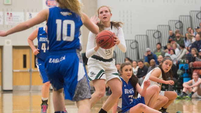 Ashley Steffeck of Fossil Ridge looks to the basket for a two point attempt during a second round playoff game against Broomfield on Friday.