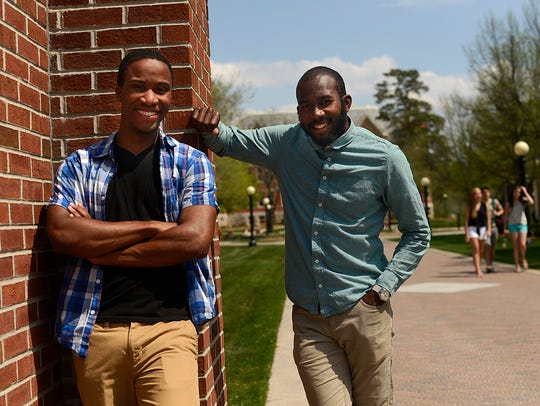 St. Norbert College students Akeem Edmonds, left, and