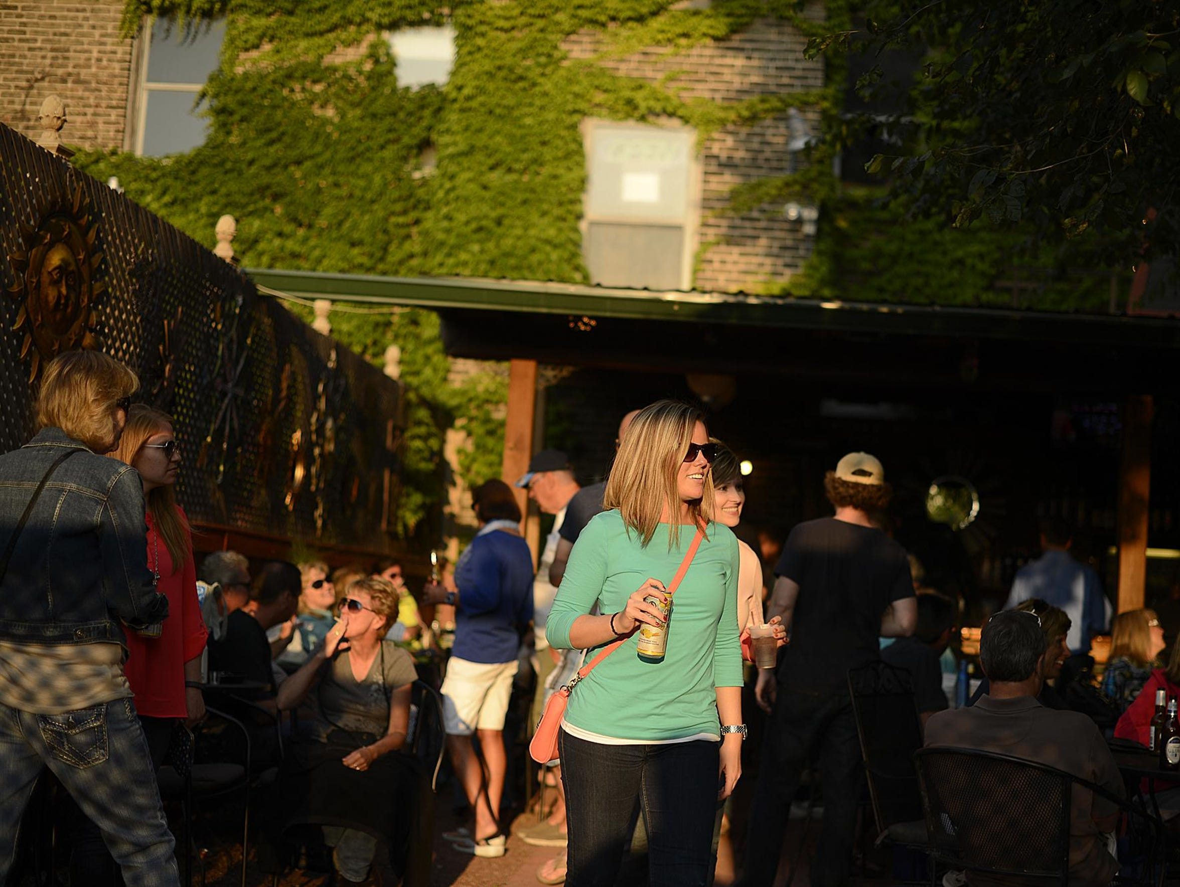 People gather at the Keggers beer garden in Green Bay