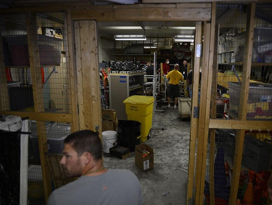 Faculty clean out damaged sports equipment at Green