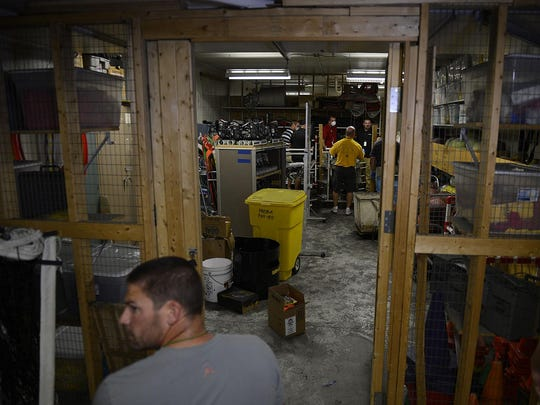 Faculty clean out damaged sports equipment at Green Bay Preble High School following an Aug. 8 fire in the school's gym.