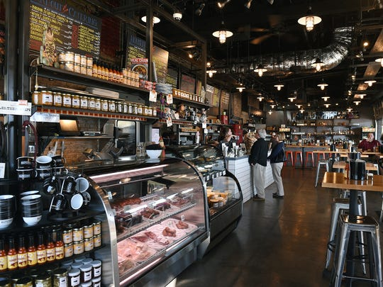 Inside Cochon Butcher is a display case of cured meats, terrines and hand-crafted sausages. Another case offers goods ready-to-go: soups, salads and sauces.