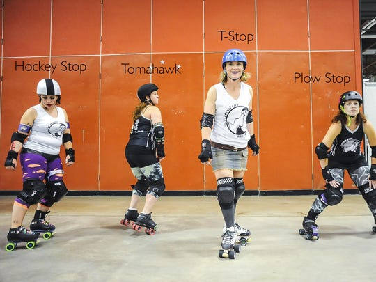 ECRG players demonstrate different ways to stop on skates. Skating skills, as well as protective wrist guards, elbow and knee pads, mouth guards and helmets, keep skaters safe on the track.