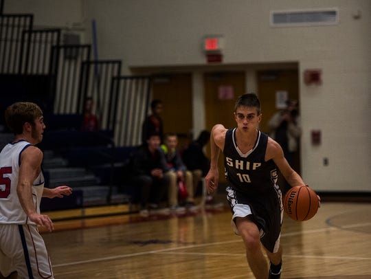 Shippensburg's Cody Gustafson drives to the basket