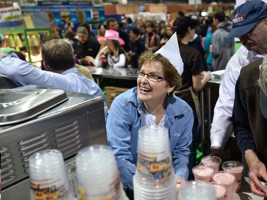 Nancy Martin smiles as she makes shakes inside the Milk Shake stand at the 100th Pennsylvania Farm Show in Harrisburg, Pa. on Saturday, Jan 9, 2016. Martin is a volunteer along with everyone working in the milkshake stall.