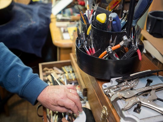 Ken Pugh grabs a tool from his tool box inside of his shop on Monday, Jan.18, 2015 in Waynesboro, Pa. Pugh use various different tools to repair and build violins, mandolins, guitar and other string acoustic instruments.