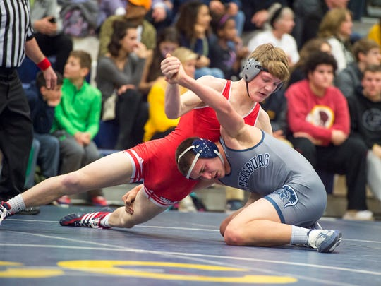Chambersburg's Drake Brenize, right, tries to hang onto Tanner Vogel of Wilson in Vogel's 3-2 win at 145 pounds. Wilson won the District Class AAA first round match on Tuesday, 39-26.
