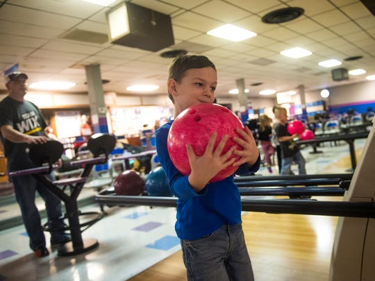 Zakkary Koontz, 5, carries his bowling ball with both hands at Hanover Bowling Centre on Super Bowl Sunday on Feb. 7, 2016.