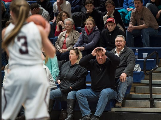 Howard Mellott reacts to a play during the District 5 girls basketball championship on Saturday. Mellott played in the first all-Fulton County District 5 boys basketball championship for Forbes Road in 1985-86 and watched his daughter, Bronwyne, play in the first all-Fulton Co. girls title game over the weekend.
