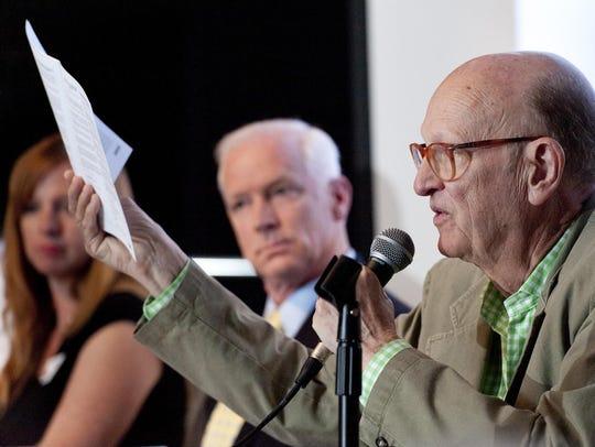 Dr. Byron Riegel speaks against Measure H to dozens