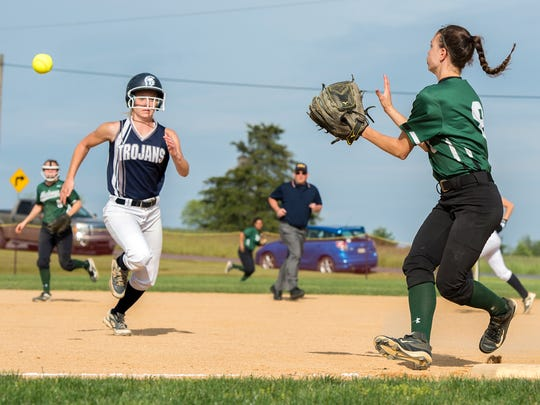 Chambersburg's Molley Keefer runs to first base as West Perry's Haylee Reisinger tries to tag Keefer out during the Mid Penn semi finals on Tuesday, May 17, 2016 in Newville, Pa. Chambersburg defeated West Perry 9-3.