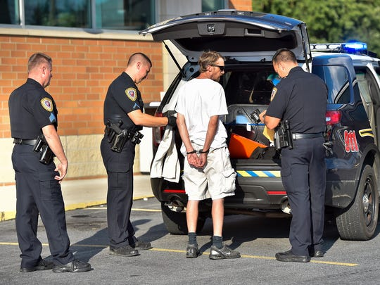 Aaron Fogelsonger is arrested after he allegedly attempted to rob the Chambersburg Walgreen's on Thursday, August 18, 2016.