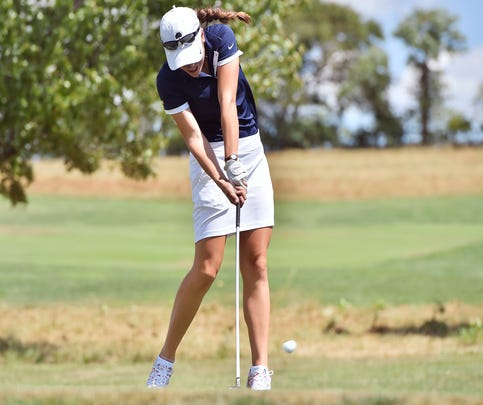 Chambersburg's Mary Kate Norcross, shown hitting a shot earlier this year, won the Mid Penn Conference girls title on Wednesday with a 77.