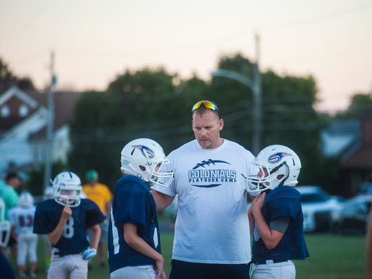Coach Joe Angleberger gives direction to Scramblers players including his son, Dawson, left, during an August practice.