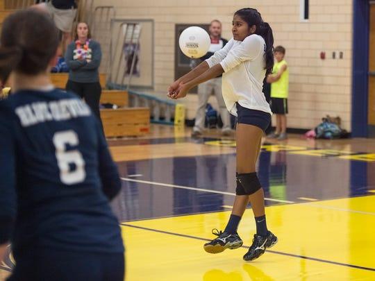 Greencastle's Kirti Venkatesh (10) bumps the ball during a girls volleyball game against Waynesboro on Tuesday, Oct. 4, 2016. Greencastle defeated Waynesboro 3-0.