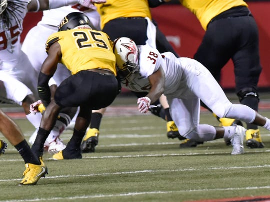 UL's Terik Miller makes a stop on Appalachian State's Jalin Moore during a 2016 game at Cajun Field.
