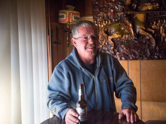 "Brian Kemper, an Abbottstown resident for 16 years, comes to the Alpine Lounge for a drink after work because of the friendly atmosphere. ""I watch it for the humor,"" he said of the football game on TV in the bar. ""I don't watch it 'cause I'm rooting for anybody. I think it's all fixed."" He's a local truck driver. ""Been doin' it for 26 years. Just changed careers."" He started out as as Mason and did that for 18 years, he said.  ""Wanted to try something different. Been doing this ever since."" Kemper said he hauls dumpsters, driving about 250 miles each day. ""It's a very good living. I meet a lot of nice people."" On moving from Abbottstown to Pittsburgh one day, Kemper takes the same approach he does for his career. ""I'm gonna try something different. I lived here all my life."" Photographed on Nov. 27, 2016."