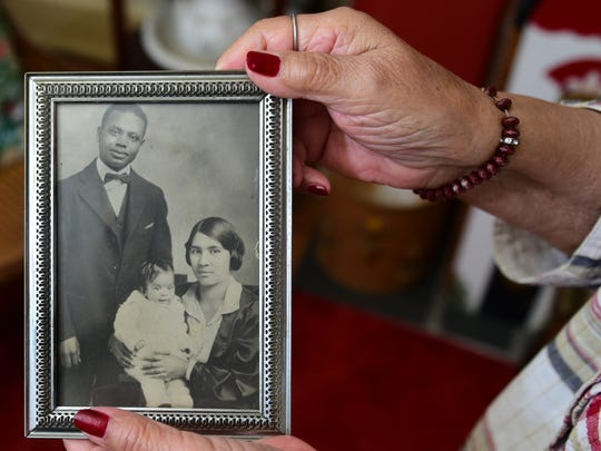 Mildred Kelly holds a photograph that features her parents (Arthur and Minnie Barbour) holding her as a toddler back in 1927. Kelly is 90 and has seen a lot of changes in racial attitudes. She said she is the oldest African-American who grew up in Chambersburg and still lives in the town.