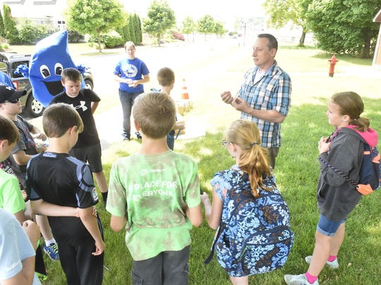A group from the Boys & Girls Club of Door County learned about stormwater run off from conservationist Brian Forest of the Door County Soil and Water Conservation Department at Martin Park in Sturgeon Bay on June 21, 2018.