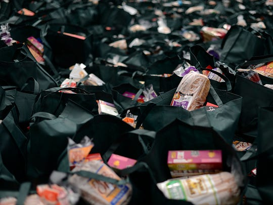 Bags of food await distribution to the hungry Wednesday