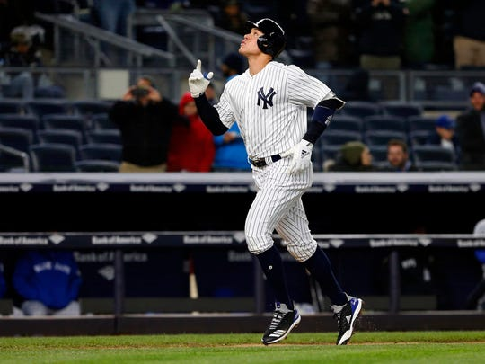 New York Yankees right fielder Aaron Judge (99) reacts rounding the bases after hitting a home run in the seventh inning against the Toronto Blue Jays at Yankee Stadium.