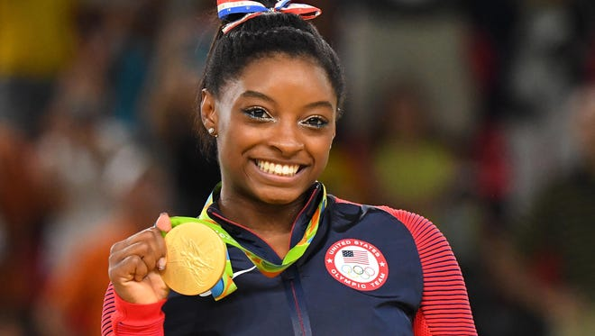 Simone Biles celebrates after winning a gold medal during the women's floor exercise final in the Rio Olympics in 2016.