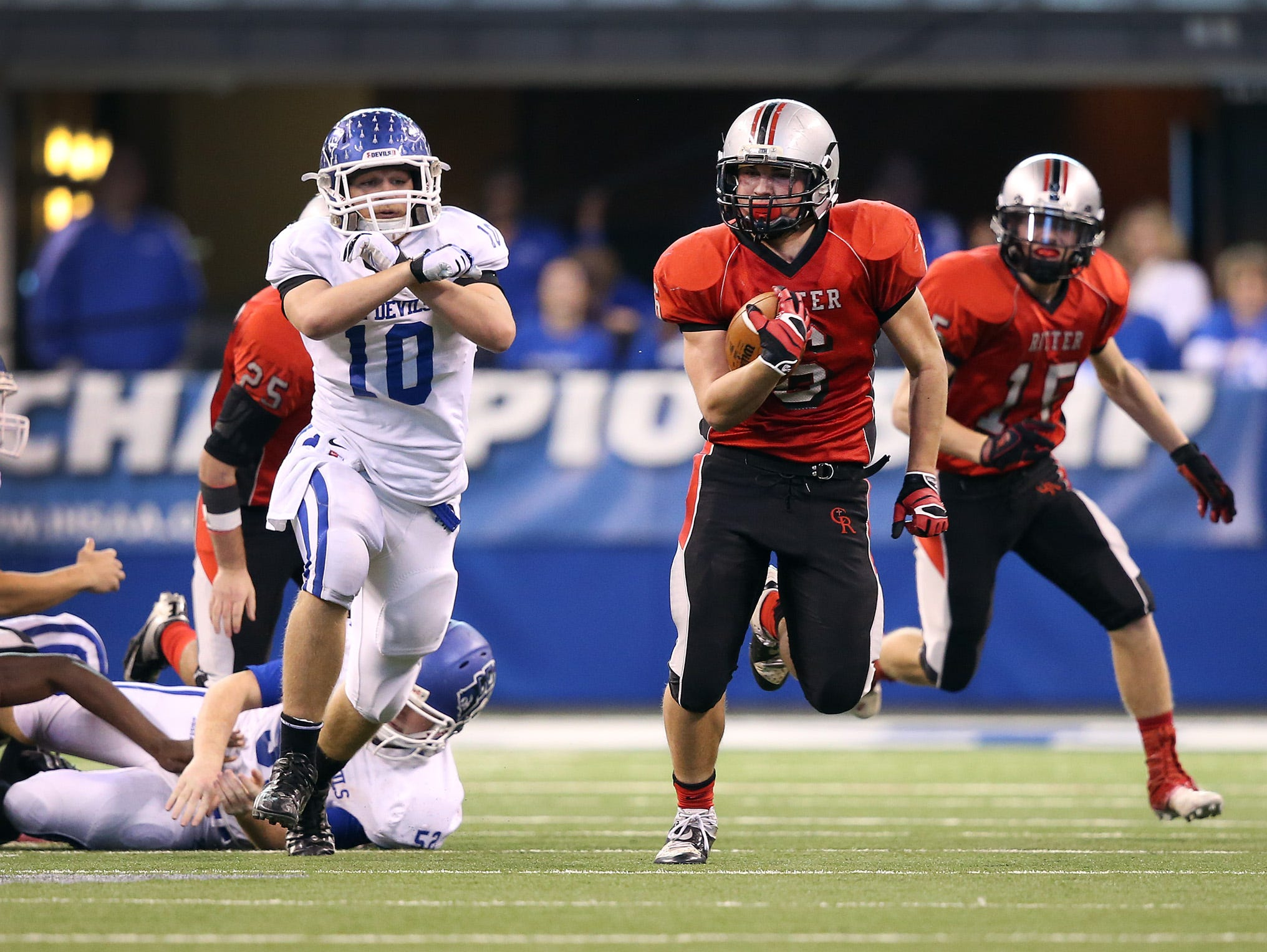 Cardinal Ritter's Tommy Waites runs back a kickoff return 89-yards for a touchdown in the 2013 IHSAA Class 2A football championship game.