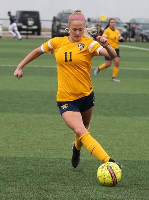 Controlling the ball during a regular season women's soccer game is Schoolcraft College sophomore forward Lauren Wynns.