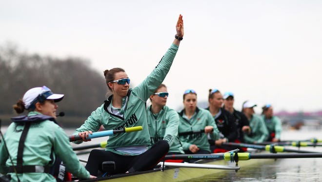Watkins Glen native Olivia Coffey of Cambridge University waves prior to the Cancer Research UK Boat Race on March 24 on the River Thames in London.