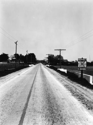 A completed section of the early two-lane DuPont Highway from the 1930s.