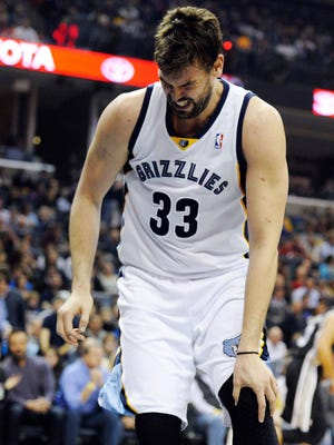 Memphis Grizzlies center Marc Gasol (33) holds his knee during the second quarter of the game against the San Antonio Spurs at FedExForum.