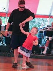 David Dunlap and his daughter Eva Dunlap  dance at the American Polish Festival Saturday, July 9, 2016 at the American Polish Century Club in Sterling Heights.