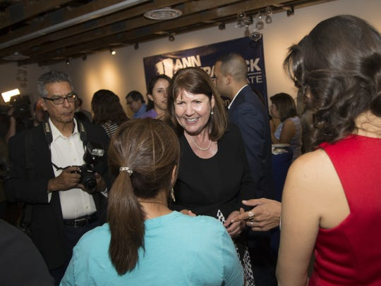 Ann Kirkpatrick greets those attending her rally during