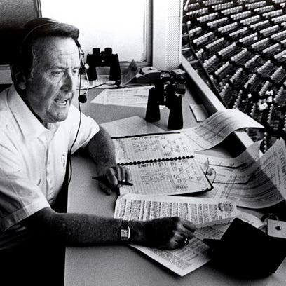 Vin Scully, shown broadcasting a game in 1989, will