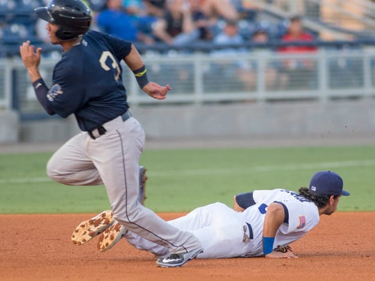 Michael Perez heads to third as third baseman Alex Blandino watches the ball that got past him during the Mobile BayBears vs. Blue Wahoos baseball game at Blue Wahoos Stadium in Pensacola, FL on Wednesday, June 15, 2016.